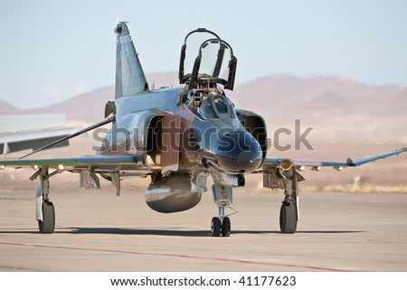 NELLIS AFB, LAS VEGAS, NV - NOVEMBER 14: McDonnel-Douglas F-4 Phantom Cold War-era fighter jet aircraft taxiing after performing at Aviation Nation 2009, November 14, 2009, Nellis AFB, Las Vegas, NV - stock photo