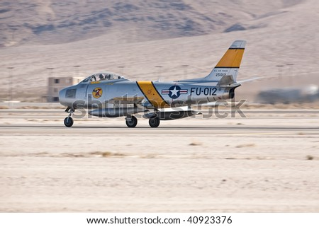 NELLIS AFB, LAS VEGAS, NV - NOVEMBER 14: North American F-86F Sabre Cold war-era fighter jet aircraft lands after performing at Aviation Nation 2009 on November 14, 2009 in Nellis AFB, Las Vegas, NV