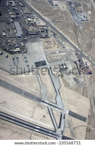 NELLIS AIR FORCE BASE, NEVADA - MARCH 30: Aerial view of Nellis AFB with section of landing strip in view.   Taken March 30, 2015 in Nellis AFB, Nevada. - stock photo