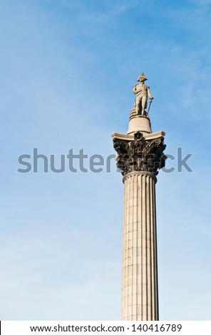 Nelson's Column monument in Trafalgar Square, London, England (against a blue sky) - stock photo