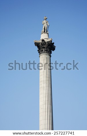 Nelson's Column stands in Trafalgar Square to commemorate Admiral Nelson - stock photo