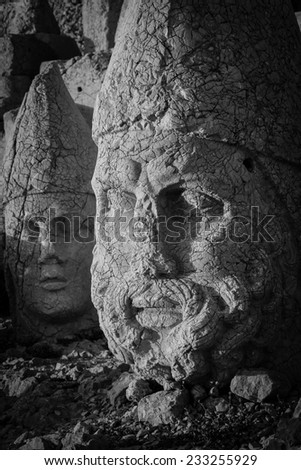 Nemrut mount, Turkey - Ancient stone heads representing the gods of the Kommagene kingdom - Black and White toned  - stock photo