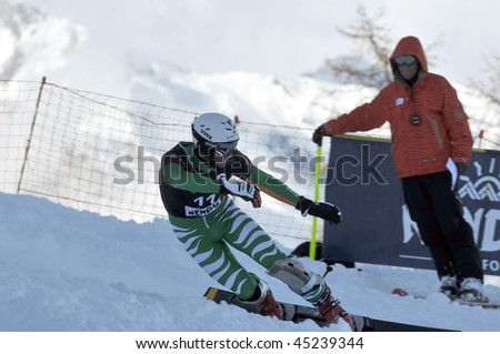 NENDAZ, SWITZERLAND - JANUARY 17: Finalist Patrick Bussler of Germany competes in the FIS World Championship Snowboard Giant Parallel Finals January 17, 2010 in Nendaz, Switzerland.