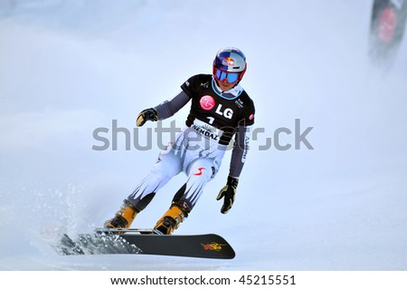 NENDAZ, SWITZERLAND - JANUARY 17: Mens bronze medal finalist Benjamin Karl of Austria competes in the FIS World Championship Snowboard Giant Parallel Finals January 17, 2010 in Nendaz, Switzerland.