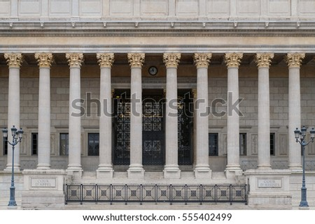 Neoclassic pillar building of the law court in Lyon, France, from a frontal perspective. Corinthian style columns decorate the main entrance.