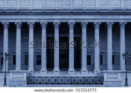 Neoclassical building front with corinthian columns colonnade, an architectural style that is often used for public buildings like law courts, libraries or universities.