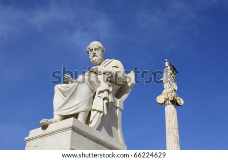 Neoclassical statues of Plato (Greek ancient philosopher) and Pallas Athena (goddess of wisdom and war) in Athens. - stock photo
