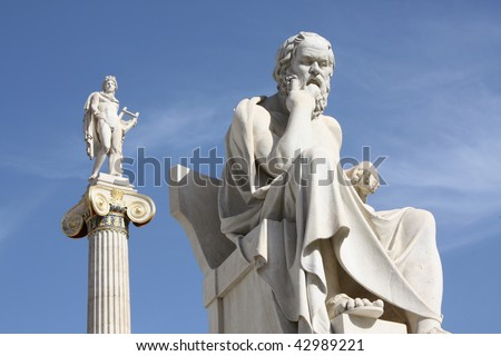 Neoclassical statues of Socrates (ancient Greek philosopher) and Apollo (god of  the sun, medicine and the arts) in front of the Academy of Athens, Greece.