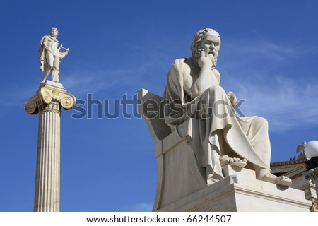 Neoclassical statues of Socrates (Greek ancient philosopher) and Apollo (god of  the sun, medicine and the arts) in front of the Academy of Athens, Greece. - stock photo