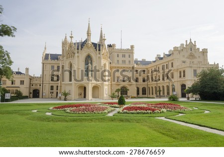 Neogothic Lednice chateau with flowering garden, Czech republic - stock photo