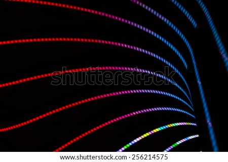 Neon abstract background of lines and bokeh - stock photo
