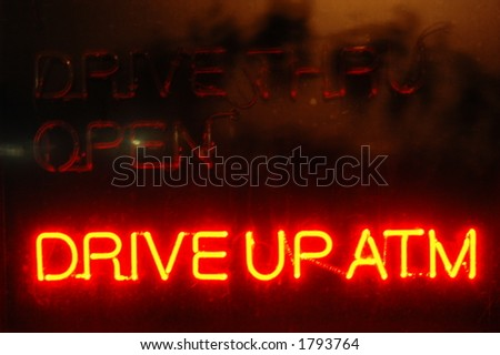 Neon ATM Bank Sign - stock photo