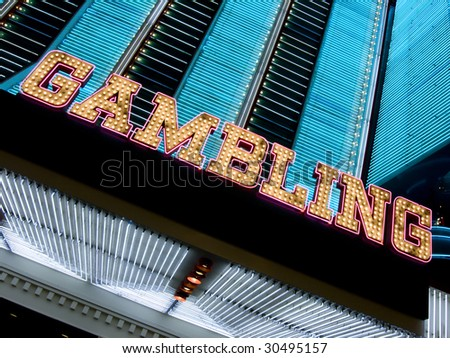 neon casino marquee with gambling sign - stock photo