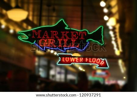Neon fish sign Pike Place MarketSeattleWA - stock photo