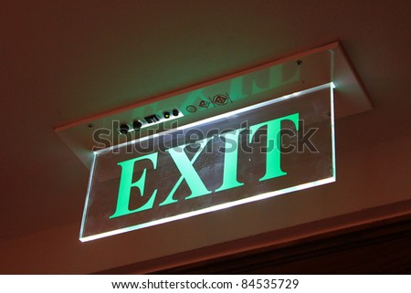 Neon Green Exit Sign - stock photo