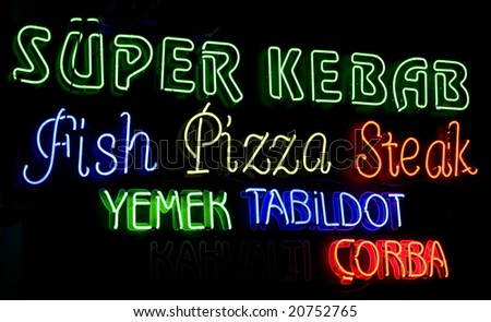 neon inscriptions on the wall of turkish cafe - stock photo