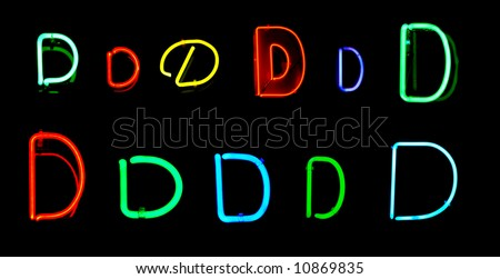 Neon letters D collected from neon signs for design elements - stock photo