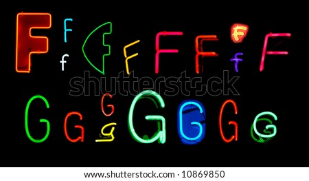 Neon letters F and G collected from neon signs for design elements - stock photo
