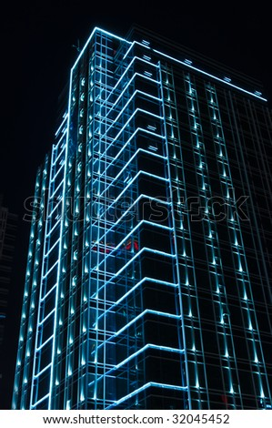 neon light decorating a modern building - stock photo