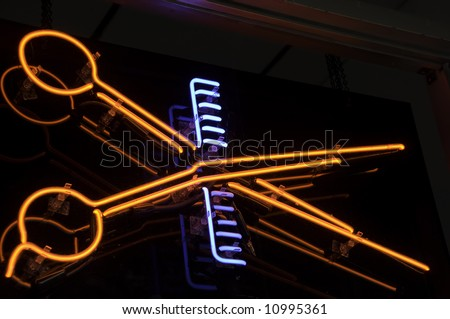 Neon light in window of barber shop - stock photo