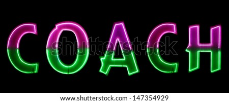 Neon light with the word COACH - stock photo