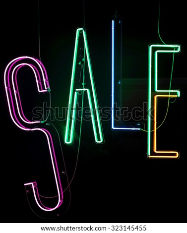 Neon Lights Sale Sign in Shop Window - stock photo