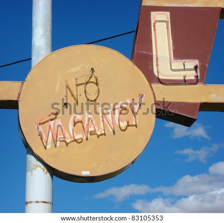 neon no vacancy sign on old roadside motel - stock photo