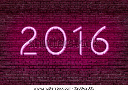 Neon numbers on the old red brick wall. Two thousand sixteen  - 2016 New Year  - stock photo