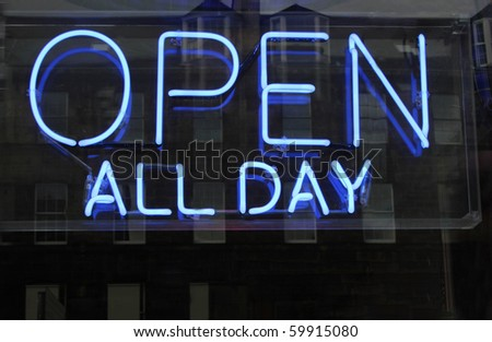 neon open sign in a shop window - stock photo