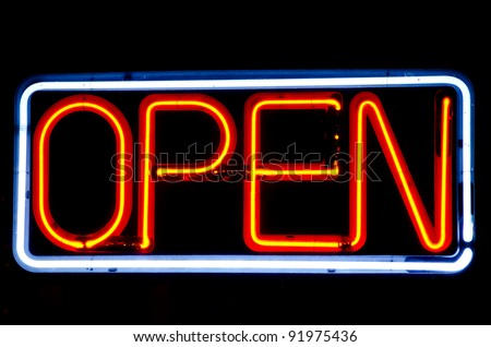 Neon Open sign lit at night - stock photo