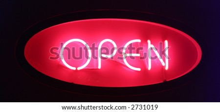 Neon open sign on a dark background - stock photo
