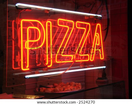 Neon pizza sign - stock photo
