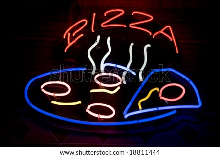 neon pizza sign in the night - stock photo