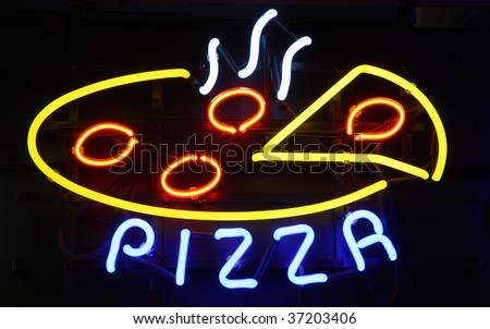 Neon Pizza Sign on Black, Copy Space - stock photo