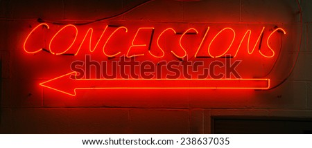 Neon red concessions sign typically found in arenas. - stock photo