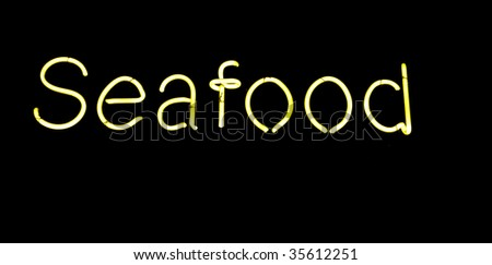 neon seafood sign - stock photo