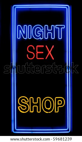 neon sex shop sign in a window