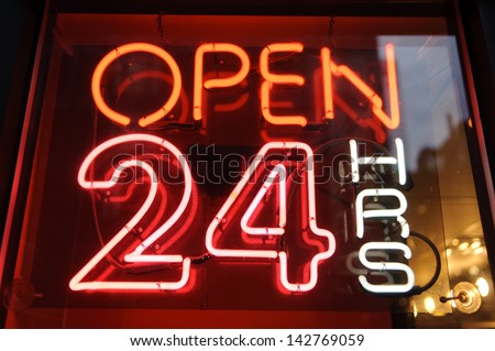 "neon shining signboard with word ""open 24"" night - stock photo"