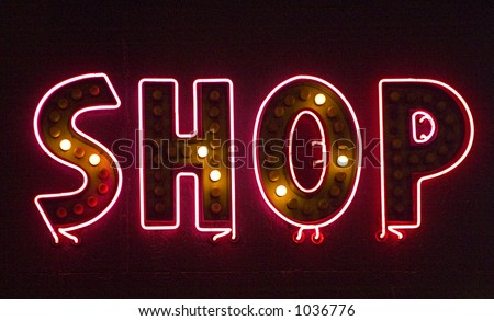 Neon shop sign with many of the lights blown out. The sign says Shop. - stock photo