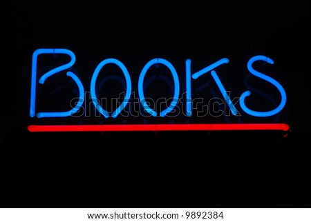 Neon sign advertising books for sale - stock photo