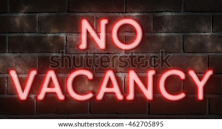"Neon sign against brick wall ""no vacancy"""