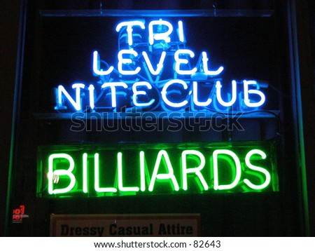 Neon sign announcing niteclub - stock photo