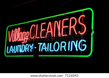 Neon sign at night - cleaners, laundry, tailoring - stock photo