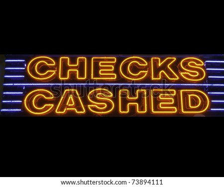 Neon sign: CHECKS CASHED - stock photo