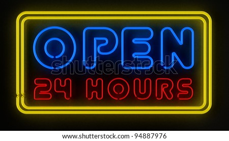 Neon sign displaying open 24 hours over dark reflective surface