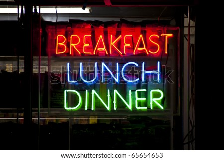 Neon sign in a restaurant window, New York City - stock photo
