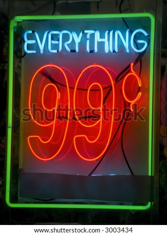 neon sign in window of 99 cent store - stock photo