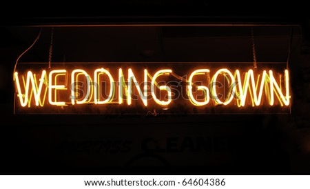 Neon sign in window of dress and bridal shop