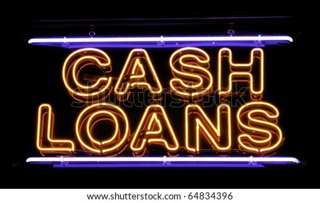 Neon sign in window of neighborhood loan shop - stock photo