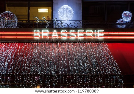 Neon sign of French bar at christmas time, Montparnasse, Paris - stock photo